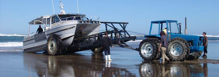 Tractor and lobster fishing boat on trailer